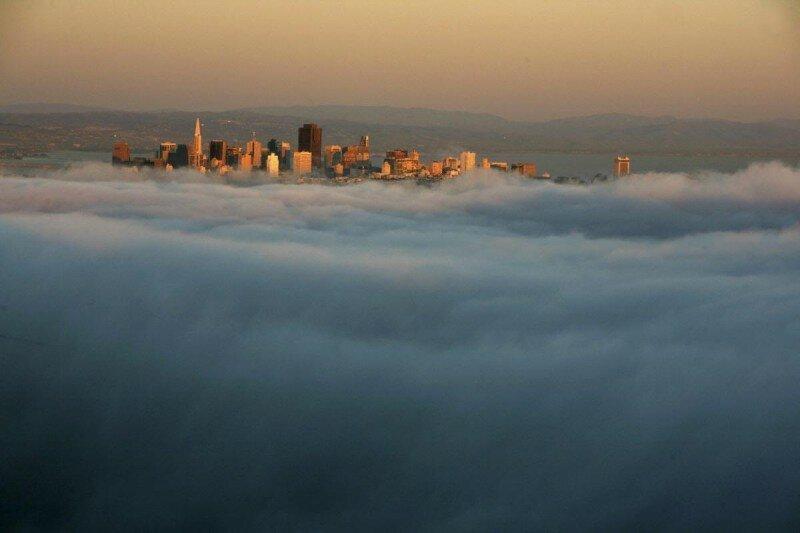 Головокружительные и завораживающие фотографии: города в облаках (12фото)