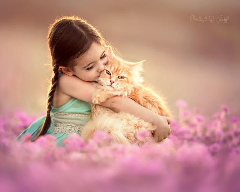 Фотограф создает очаровательные снимки своей дочери с разными животными (11фото)
